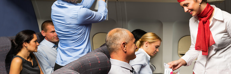 Air hostess talking to passenger